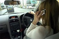 Woman driving whilst on mobile phone